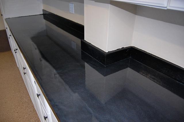 Tan Floor And Black Metallic Countertop